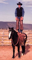 Blue Allen standing on horse in old photo